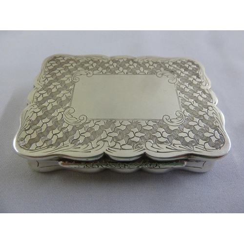 367 - A Continental white metal snuff box, shaped rectangular with engine base and hinged cover, circa 187...
