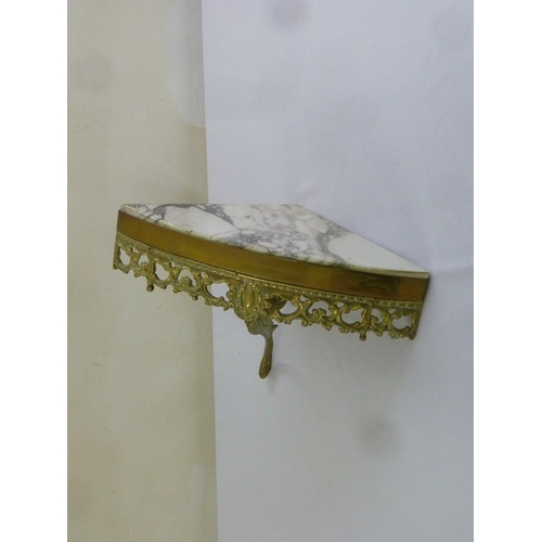 37 - A brass and marble wall mounted corner table, marble A/F...