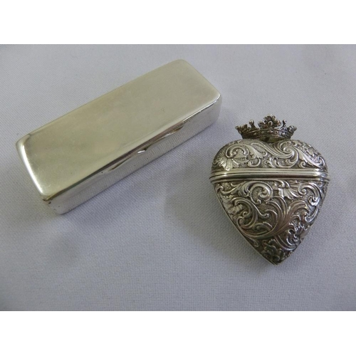 373 - A Victorian silver snuff box, plain rectangular with hinged cover circa 1850 and a Continental white...