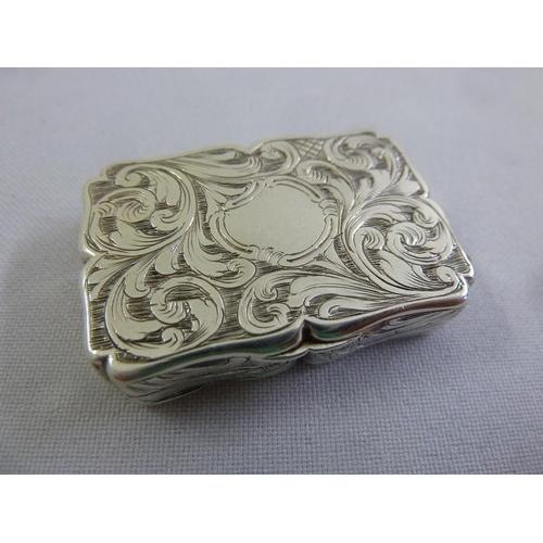 378 - A Victorian silver vinaigrette, rounded rectangular, leaf engraved, Birmingham 1842...