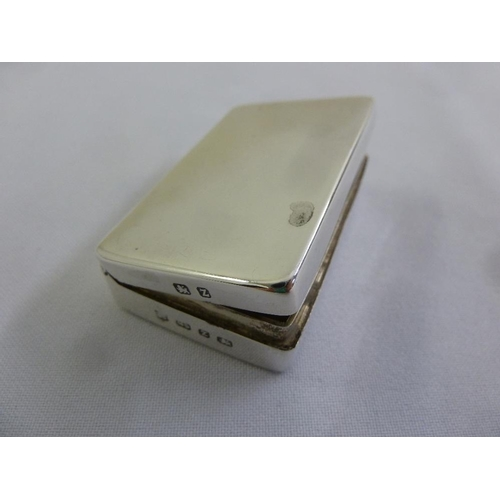 379 - A late Victorian silver snuff box, plain rectangular with hinged cover, Birmingham 1899...