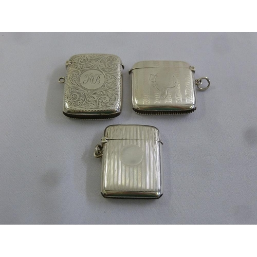 380 - Three silver hallmarked vesta cases of rounded rectangular form...
