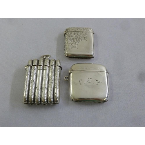 381 - Three silver hallmarked vesta cases, rounded rectangular, one with ribbed sides and cover...