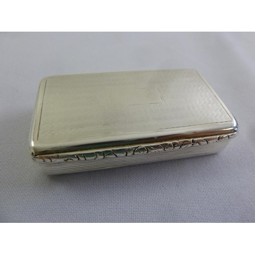 382 - A Georgian silver snuff box, rounded rectangular, ribbed sides, engine turned cover, Birmingham 1827...