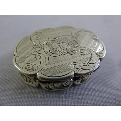 383 - A Victorian silver vinaigrette, shaped oval with leaf and floral decoration and a pierced florally e...