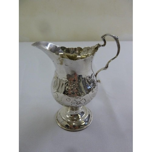 390 - A George III silver cream jug with scroll handle, marks rubbed, A/F...