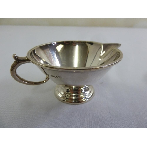 392 - Silver cream jug shaped circular on raised circular base , Sheffield 1943...