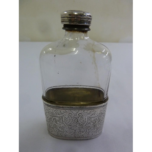 398 - A white metal mounted hip flask with leaf engraved pull-off beaker...