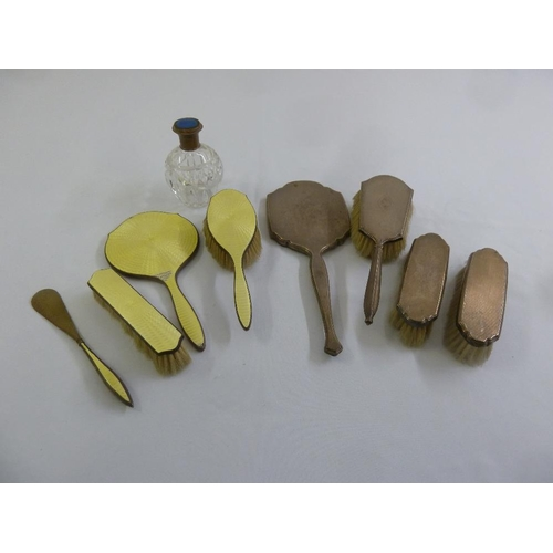 399 - A quantity of silver to include a dressing table set, a scent bottle and clothes brushes, A/F, (9)...