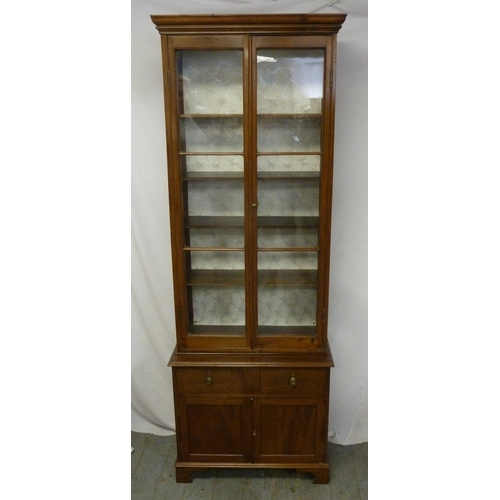 4 - A rectangular mahogany display cabinet with glazed top section above two drawers and cupboard...
