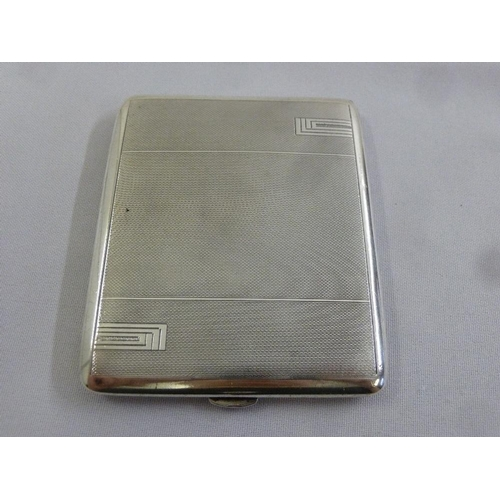 402 - A silver engine turned cigarette case, Birmingham 1934...