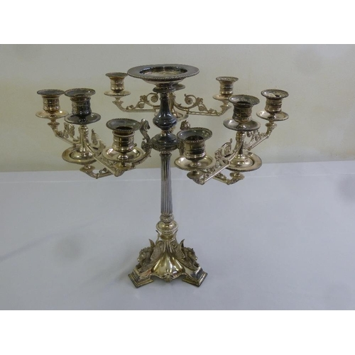 408 - A silver plated nine light candelabrum, scrolling arms, tapering ribbed stem, the trefoil base surmo...