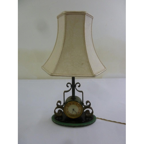 41 - A table lamp clock with scroll mounts and silk shade...