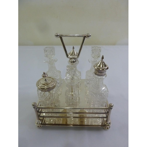 413 - Silver plated cruet stand with six cut glass condiment bottles...