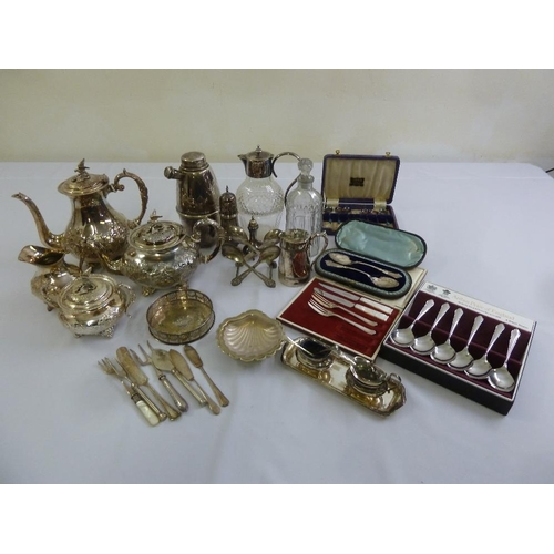 417 - A quantity of silver plate to include a teaset, cocktail shaker, decanters and flatware...