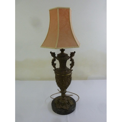 42 - A bronze table lamp in the form of a vase on marble base with silk shade...