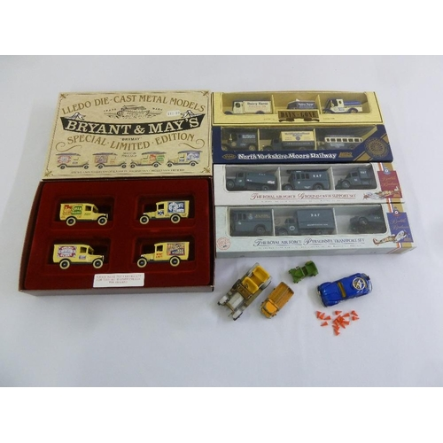 422 - A quantity of diecast vans in original packaging...