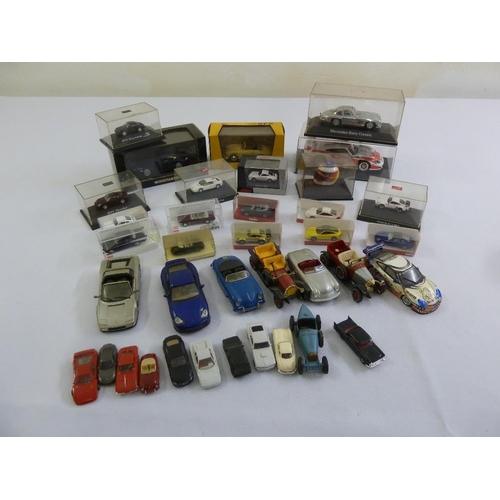 429 - A quantity of diecast model cars to include Schuco, Corgi and Busch...
