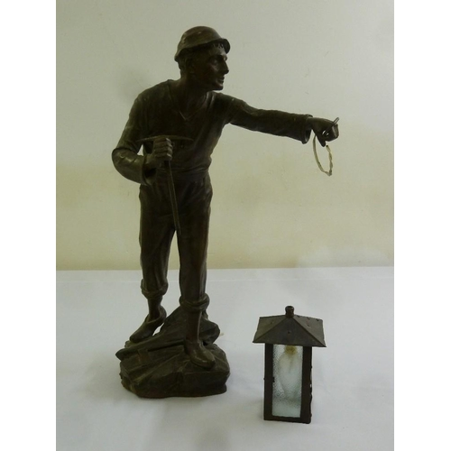 43 - A brass lamp stand in the form of a miner holding a lamp, A/F...