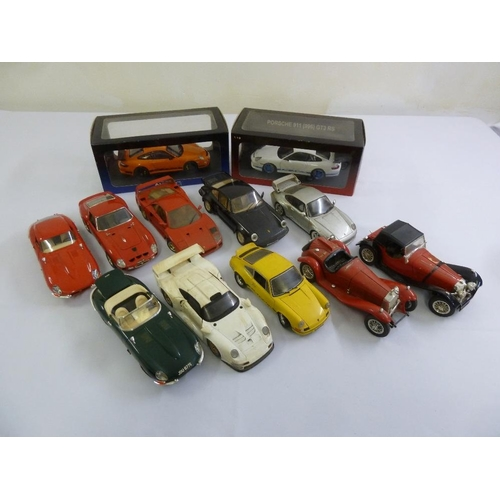 434 - A quantity of diecast model cars to include Polistil, Burago, UT models and Autoart, two boxed  (12)...