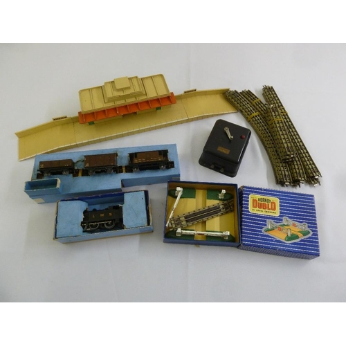 439 - A quantity of model railways to include Hornby Dublo, trucks, track, station and LMS locomotive  (7)...
