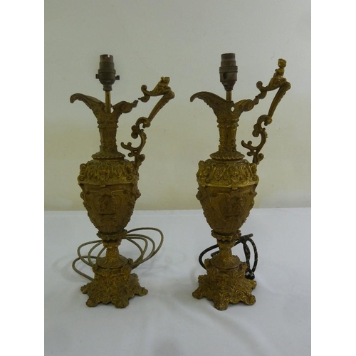 45 - A pair of spelter urns in classical style converted to electric lamp bases...