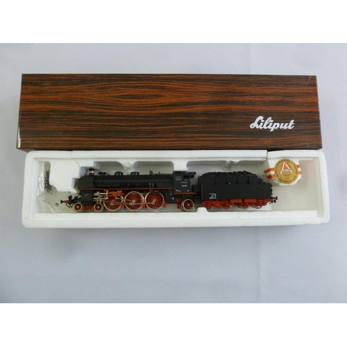 455 - Liliput HO gauge 1803 locomotive and tender, mint condition in original packaging...