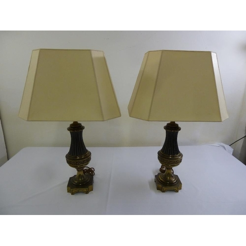 47 - A pair of cast gilt metal lamp bases with silk shades...
