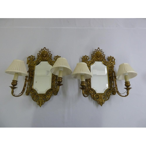 49 - A pair of brass and mirrored hall wall two branch lights...