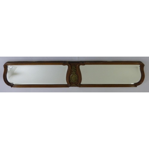 50 - A French shaped rectangular wall mirror with brass mounts to the centre...