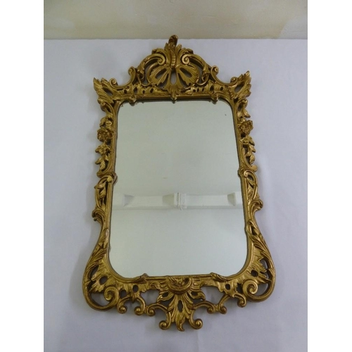 52 - A French baroque style gilded wall mirror...