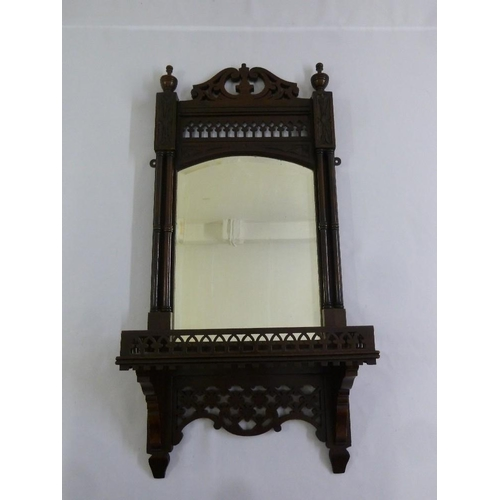 55 - A mahogany framed wall mirror in Gothic style...