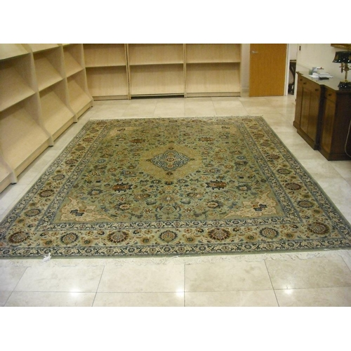 57 - A Persian wool carpet, light blue ground with repeating medallions, swags and flowers, 422 x 319cm...