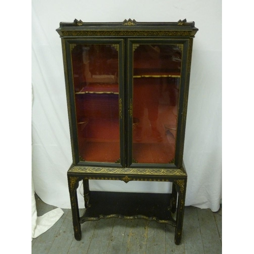 8 - A Chinese style lacquered cabinet, with glazed doors and painted side panels on rectangular stand wi...