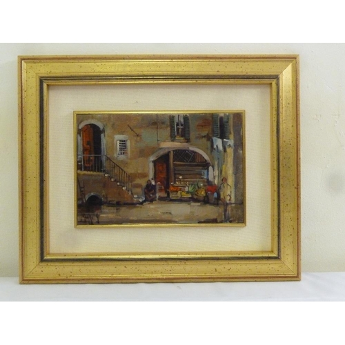 82 - Maggi oil on board of a Continental shop scene, signed bottom left, 20 x 30cm...