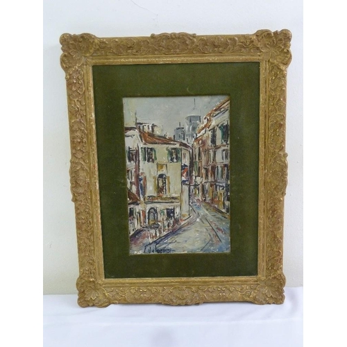 85 - An oil on canvas of Continental street scene in decorative gilded frame, signed bottom left, 29 x 19...