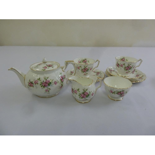 99 - Aynsley tea for two Grotto Rose pattern to include teapot, milk jug, sugar bowl, teacups, plates and...