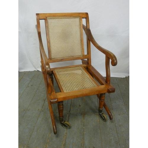 13 - A Victorian sedan chair on original brass castors...