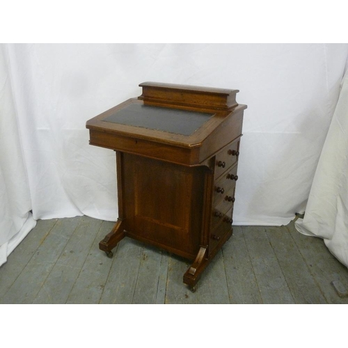 17 - A late 19th century mahogany Davenport of customary form with tooled leather top...