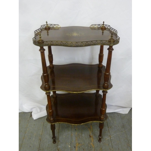 18 - A French mahogany and brass three tier whatnot on turned tapering cylindrical legs...