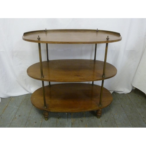 19 - An oval three tier mahogany whatnot with brass gallery and supports...
