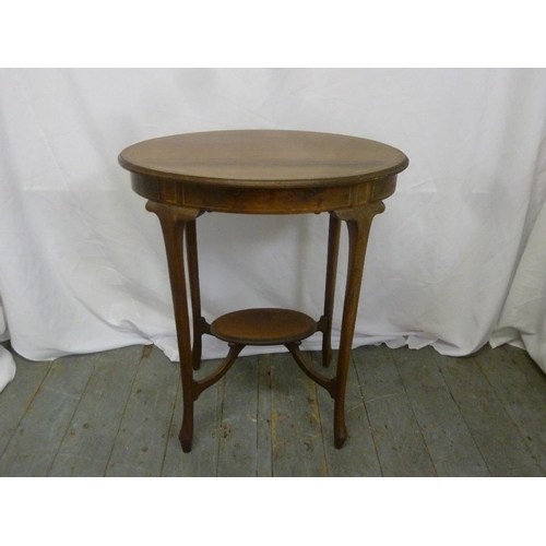 20 - An Edwardian mahogany oval side table with satinwood inlay...