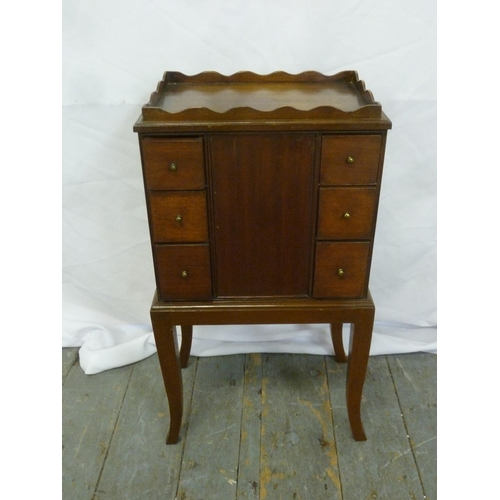 23 - An Edwardian rectangular mahogany cupboard with drawers to one side and cupboard to reverse on stand...