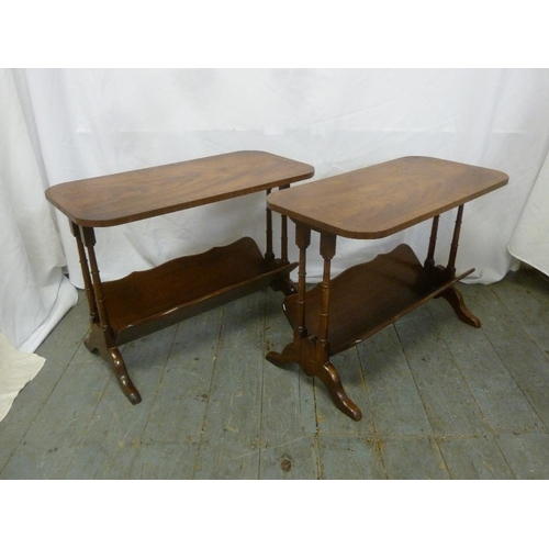 24 - A pair of Bevan Funnel rounded rectangular side tables with magazine racks to bases...