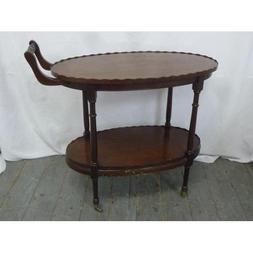 25 - An early 20th century mahogany oval tea trolley...
