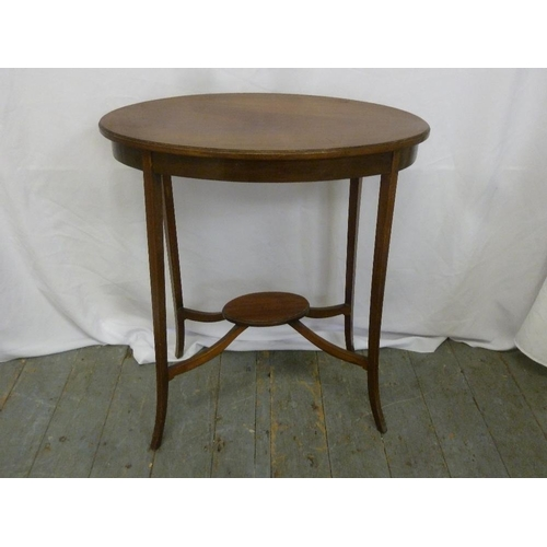 26 - An Edwardian oval side table on four tapering legs...