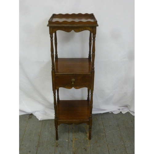 27 - A three tier rectangular mahogany whatnot on turned legs...