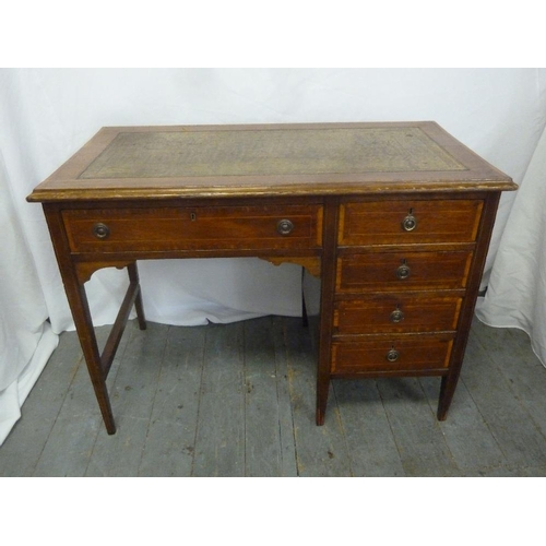 3 - An Edwardian rectangular knee hole desk, the five drawers with brass handles...