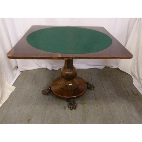 5 - A Victorian mahogany games table on pedestal base with claw feet...