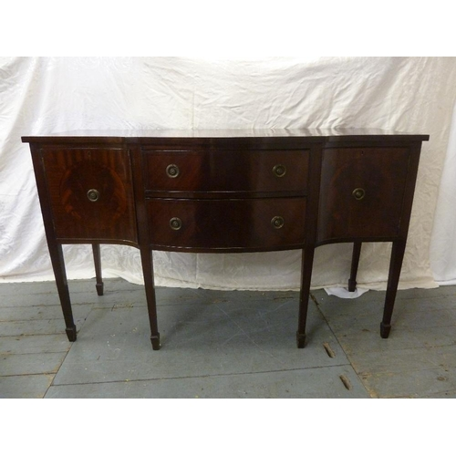 6 - A Regency style mahogany sideboard with two drawers flanked on either side by two cupboards on taper...